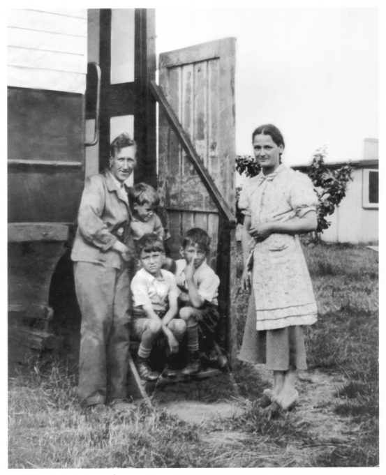 At the door of the railway vehicle. Frederick and Rosina Gibbons with sons, Peter on the left, Jack on the right and Billy above.