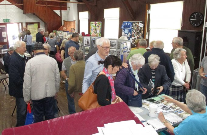 Lots of interest in the merchandise table.