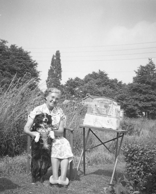 My grandmother Sarah Hunt with dog Chum and pet budgies.