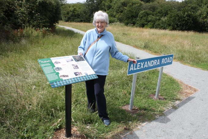 A former resident delighted with the new road sign andf lectern.