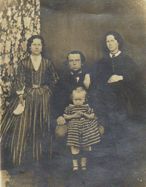 Unknown female with John Carter (seated), Frank Carter and Anna Carter (nee Murray) - 1863.