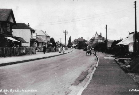 A picture postcard of Laindon High Road in the Thirties.